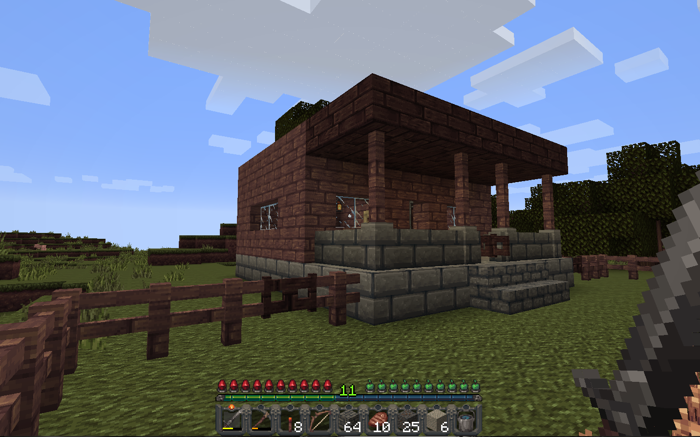 A minecraft house with the Mythic Resource Pack textures downloaded