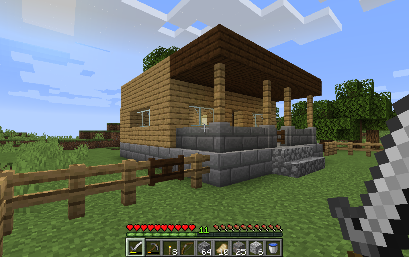 A view of a house made in minecraft with the regular textures