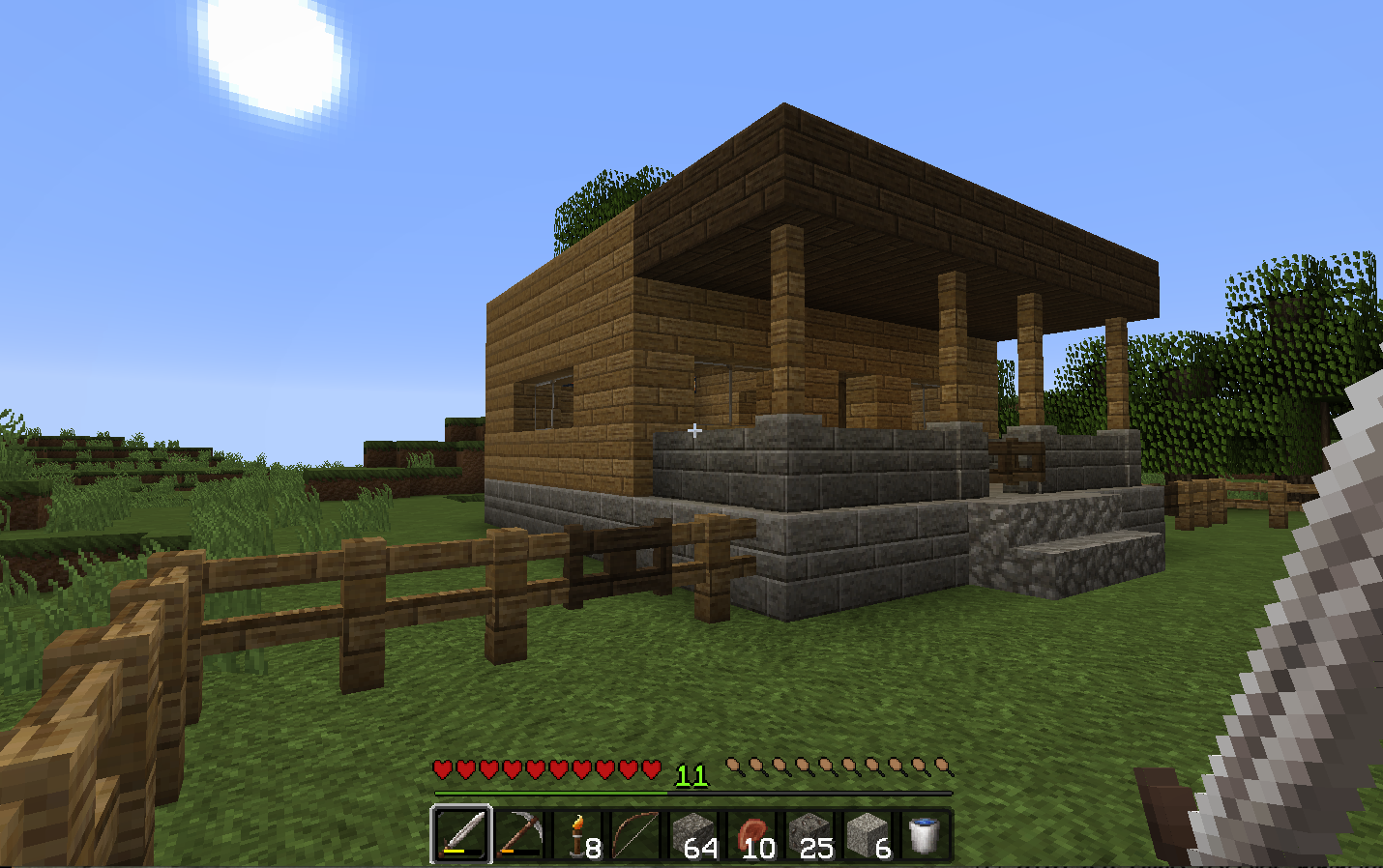A view of a house in minecraft with the clarity Resource Pack textures downloaded